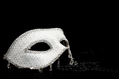 Silver glittering mask and pearls Royalty Free Stock Images