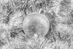 Silver glittery Christmas ornament in silver tinsel stock photos