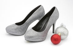 Silver glittery high heeled shoes with christmas decorations Royalty Free Stock Image
