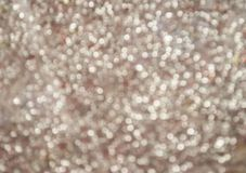 Silver glitter texture. Bokeh effect. Silver glittery shimmering background with blinking details stock images