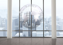 Silver globe floating in room Stock Photo