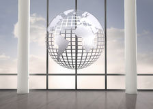 Silver globe floating in room Stock Images