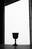 Silver goblet. Silver cup in a window, black and white Royalty Free Stock Photo