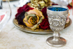 Silver Goblet on Table with Roses Centrepiece Royalty Free Stock Images