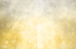 Silver gold background with bright sunshine on bokeh circles or bubbles in bright white light. Abstract gold background bokeh lights and faint white sunshine Royalty Free Stock Photos