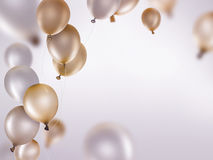 Silver and gold balloons. On light background Stock Photos