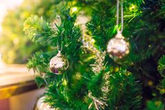 Silver and gold balls on a Christmas tree stock photos