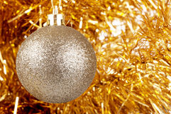 Silver gold bauble on the Christmas tree. Stock Photos