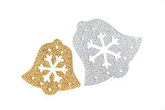 Silver and Gold bells in snowflake signs Royalty Free Stock Image