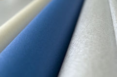 Silver, Gold and Blue Rolls Royalty Free Stock Photos