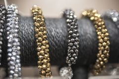 Silver and gold bracelets in defocus.  royalty free stock image