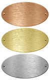 Silver, gold and bronze metal ellipse plates isolated. With clipping path included royalty free stock images