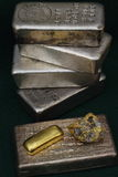 Silver & Gold Bullion Bars (Ingots) and Gold / Quartz Specimen Royalty Free Stock Photo