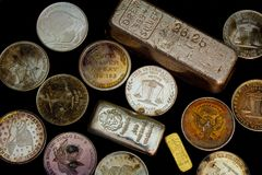 Silver and Gold Bullion - Bars and Rounds. Precious Metals royalty free stock photography