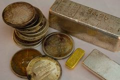 Silver and Gold Bullion - Bars and Rounds. Precious Metals royalty free stock photos