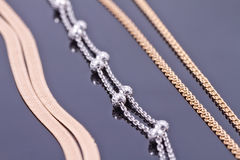 Silver and gold chains Royalty Free Stock Photos