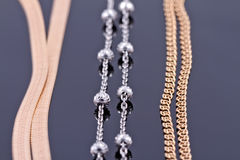 Silver and gold chains Royalty Free Stock Photography