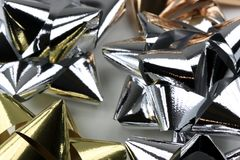 Silver and Gold Christmas Bows Royalty Free Stock Images