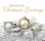 Silver gold Christmas decoration. Silver and gold Christmas decoration balls on white background Royalty Free Stock Images