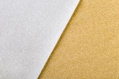 Silver and gold christmas glitter paper background. Silver and gold glitter background, two tone christmas wrapping paper stock image