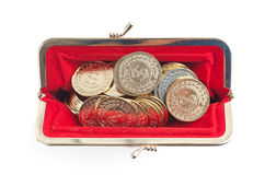 Silver and gold coins are in hot red purse Stock Photo