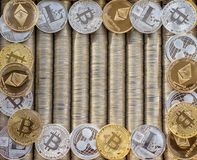 Silver Gold Crypto coins Ethereum ETH, Ripple XRP, Litecoin LTC, bitcoin BTC. Free space for text. Metal coins are laid out in bac stock photography
