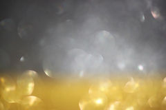 Silver and gold defocused lights. abstract sparkle bokeh lights Stock Images