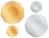 Silver and Gold Doilies. Decorative silver and gold lace doilies for holidays, celebrations, arts and crafts, scrap books, decorating, sewing, setting table and Stock Photo