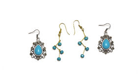 Silver and Gold Earrings with Turquoise Beads Stock Photos