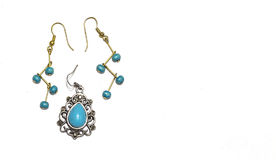 Silver and Gold Earrings with Turquoise Beads Royalty Free Stock Photography