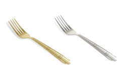 Silver and gold forks Stock Photos