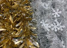 Silver and gold garland with snowflakes royalty free stock images