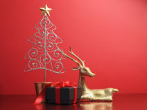 Silver and gold glitter Christmas tree and reindeer ornaments - with copy space. Stock Image