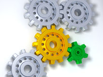 Silver, gold and green gears Royalty Free Stock Photography