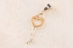 Silver and gold key pendant necklace Royalty Free Stock Images