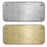 Silver and gold metal plates. Isolated Royalty Free Stock Photo
