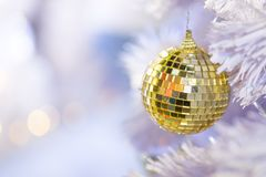 Silver and gold mirror balls on a white Christmas tree stock photography