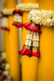 Silver and gold pedestal and Jasmine garland Stock Photography