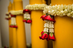 Silver and gold pedestal and Jasmine garland Royalty Free Stock Photo