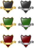 Silver and gold shield and ribbon Stock Images