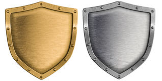 Silver and gold shields set isolated on white Royalty Free Stock Photos