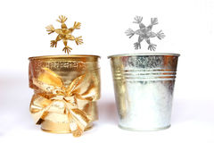 Silver and gold stars. Two stars and two little pails. Silver & gold decoration Stock Photos