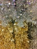 Silver and gold tinsel. Silver and gold Christmas decoration tinsel hanging on display in store Royalty Free Stock Image