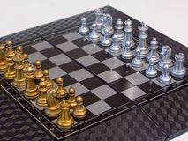 Silver and gold. A wonderful chess set of golden and silver color make you want to start the game Stock Image