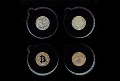 Silver and Golden Bitcoins on Display, Black background royalty free stock photography