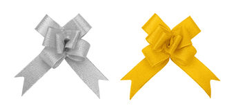 Silver and golden bow cutout. Silver and golden fabric textile bow isolated on white with clipping path Stock Photography