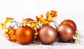Silver and golden Christmas balls Royalty Free Stock Photos