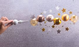 Silver and golden christmas bubbles. Christmas spell - Silver and golden christmas bubbles and stars decorations flying stock image