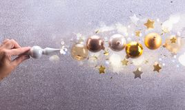 Silver and golden christmas bubbles. Christmas spell - Silver and golden christmas bubbles and stars flying royalty free stock images