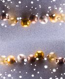 Silver and golden christmas bubbles. Flat lay top view frame stock images